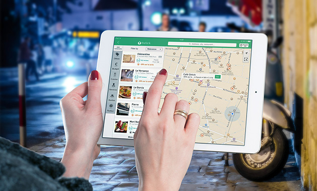 hands pointing over digital map on a tablet