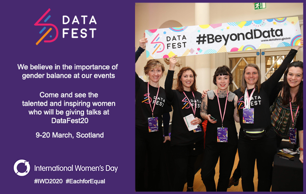 Photo of women holding #BeyondData sign above their heads at DataFest event
