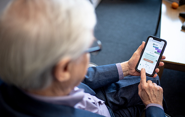 Elderly man using app on mobile phone