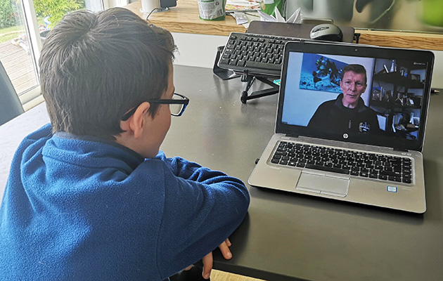 School kid watching live webinar with Tim Peake